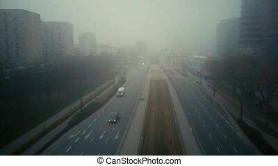 Flight over blurred city street in fog - Aerial of foggy...
