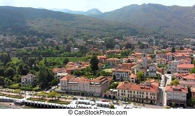 flight over city on Maggiore lake bank - flight over small...