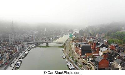flight over city on river bank - flight over Dinart city on...
