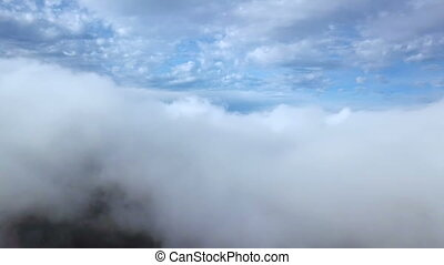 Flight over clouds. Aerial