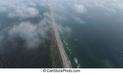 flight over clouds at seashore at evening