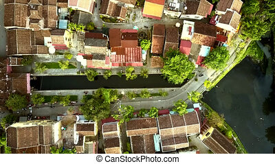 flight over colorful roofs along channel crossing quarter -...
