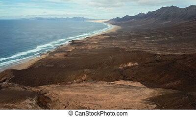 Flight over desert beach on Fuerteventura island, Spain