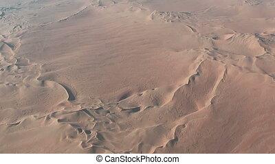 Flight over desert dunes in namibia