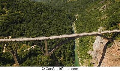 Flight over Djurdjevica Bridge across the Tara River Canyon. Montenegro.
