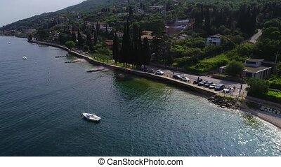 flight over Garda lake in Northen Italy - flight over blue...