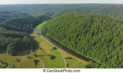 flight over green river valley in Belgium