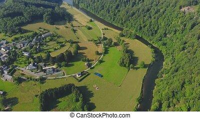 flight over green river valley in Belgium