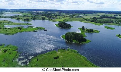 flight over lakes and meadows land - flight over blue lakes...