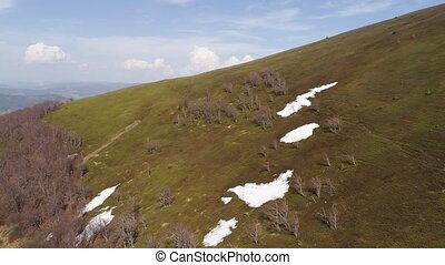 Flight over mountain slopes without vegetation with...
