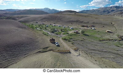 flight over nomadic yurt camp in Altay mountains