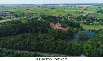 flight over old castle in green forest - flight over old red...