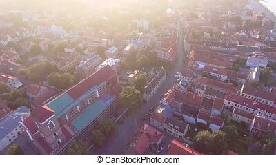 flight over old town in the morning