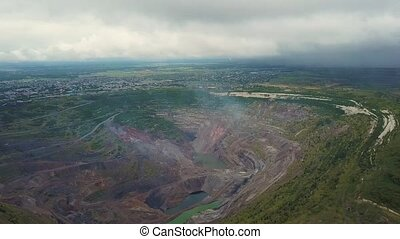 Flight over open cast mine. Aerial view of industrial...