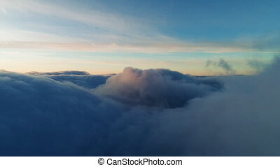 Flight over real dusk clouds