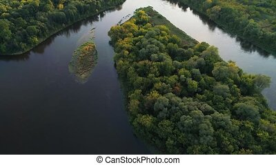 flight over river and forest at evening