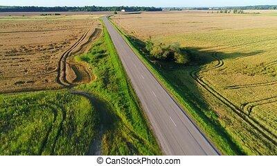 flight over road in summer fields