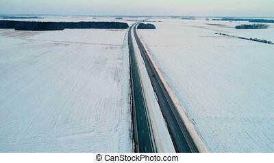 flight over road in the winter fields