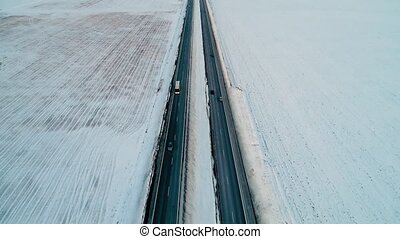 flight over road in the winter fields - flight over road in...