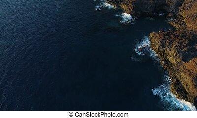 Flight over seashore at Tenerife near Los Gigantes mountains