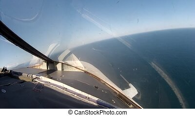 Flight over  ship sea view from cockpit plane.