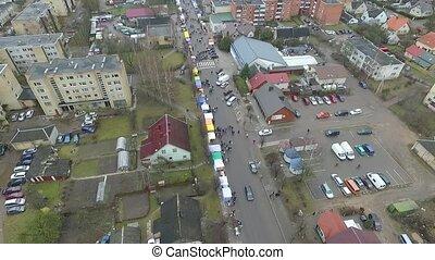 Flight Over Small Town, Fair On Street