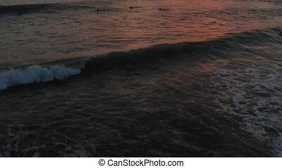 Flight Over Surfers Surfing Ocean Waves at Sunset. Amazing...