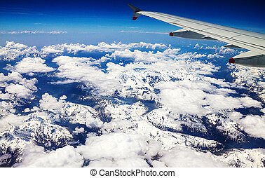Flight over the Alps, Flight over the Alps, snow-capped Alpine peaks visible glacier.