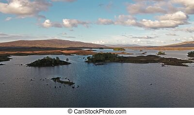 Flight over the amazing landscape of Rannoch Moor next to...