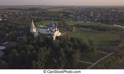 Flight over the architectural ensemble of Suzdal Kremlin with Cathedral of the Nativity of the Virgin
