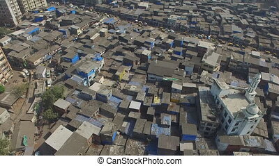 flight over the city slums of Mumbai (India)