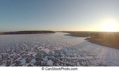 flight over the frozen reservoir