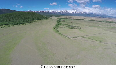 flight over the mountain valley - Altai, Russia