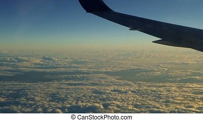 Flight over the ocean above cloud cover