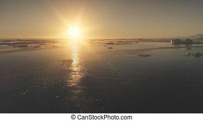 Flight over the ocean. Sunset light. Antarctica. -...