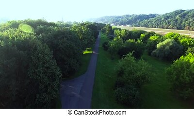 flight over the park - flight over the green park in the...
