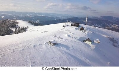 Flight over the research station on top of Carpathian mountains covered with snow. Clear frosty weather