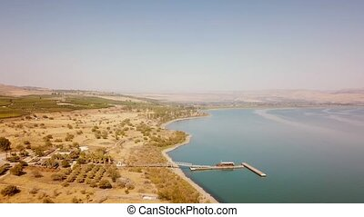 Flight over the Sea of Galilee and farmland.