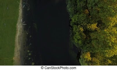 Flight over the Seim River, Ukraine surrounded by trees, view from the top - aerial videotaping