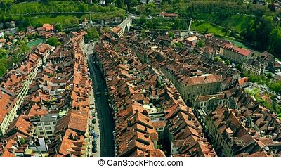 Flight over tiled roofs of the Old City of Bern, Switzerland...