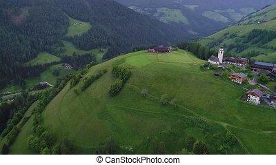flight over village in mountains - flight over village in...