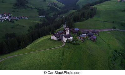 flight over village in mountains - flight over village in...