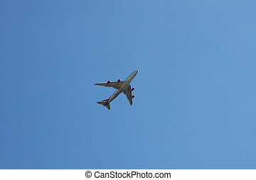 Flight Path - Passenger airline flying across a clear blue...