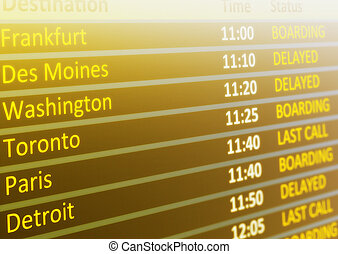 Flight schedule - Airport flight schedule board showing time...