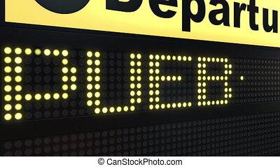 Flight to Puebla on international airport departures board...