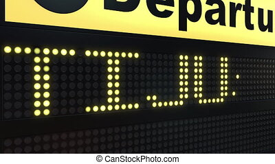 Flight to Tijuana on international airport departures board...