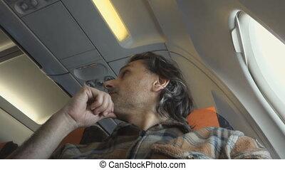 flight traveller - man sitting in an airplane