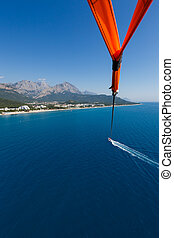 Flight with a parachute over the sea