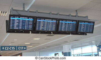 Flights Information Board in an Airport Terminal