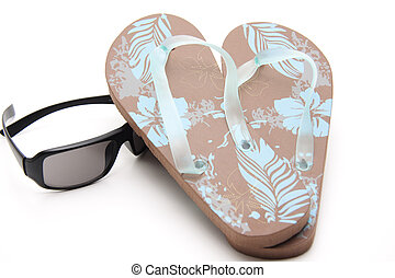 Flip flop with sunglasses on white background
